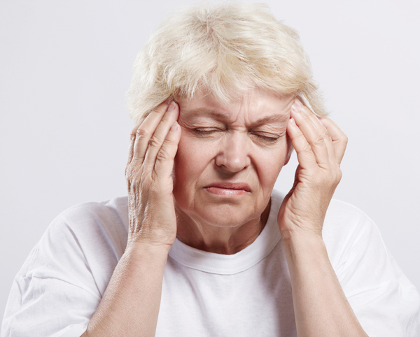 woman in pain with migraine