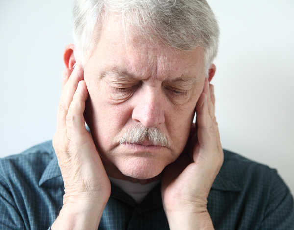 man with ear pain from TMJ